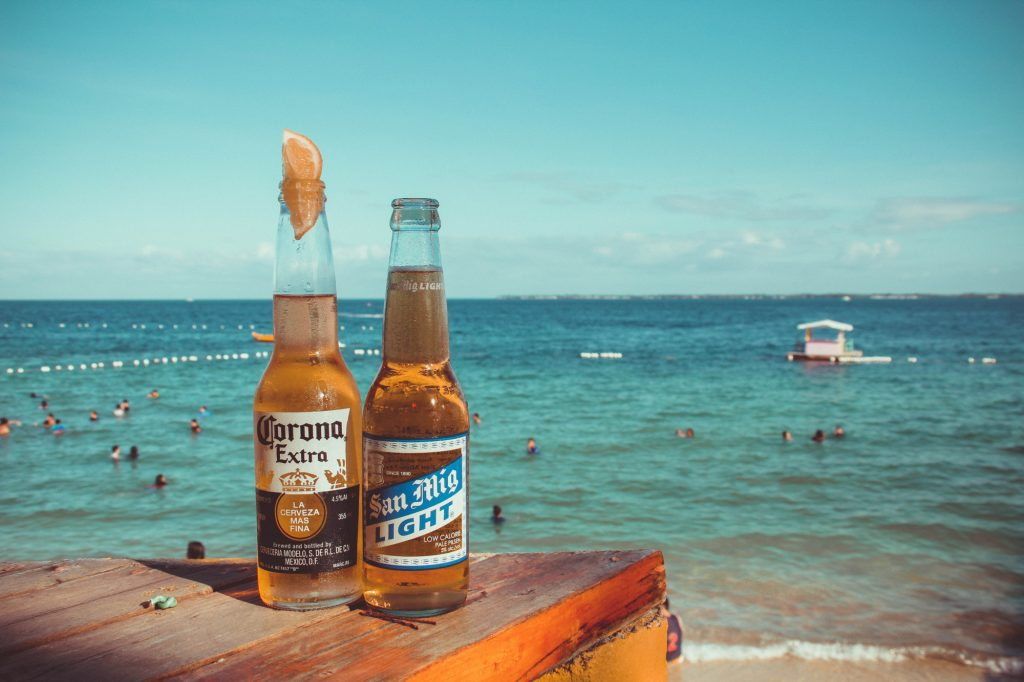 Mexican beers with a beach in the background.